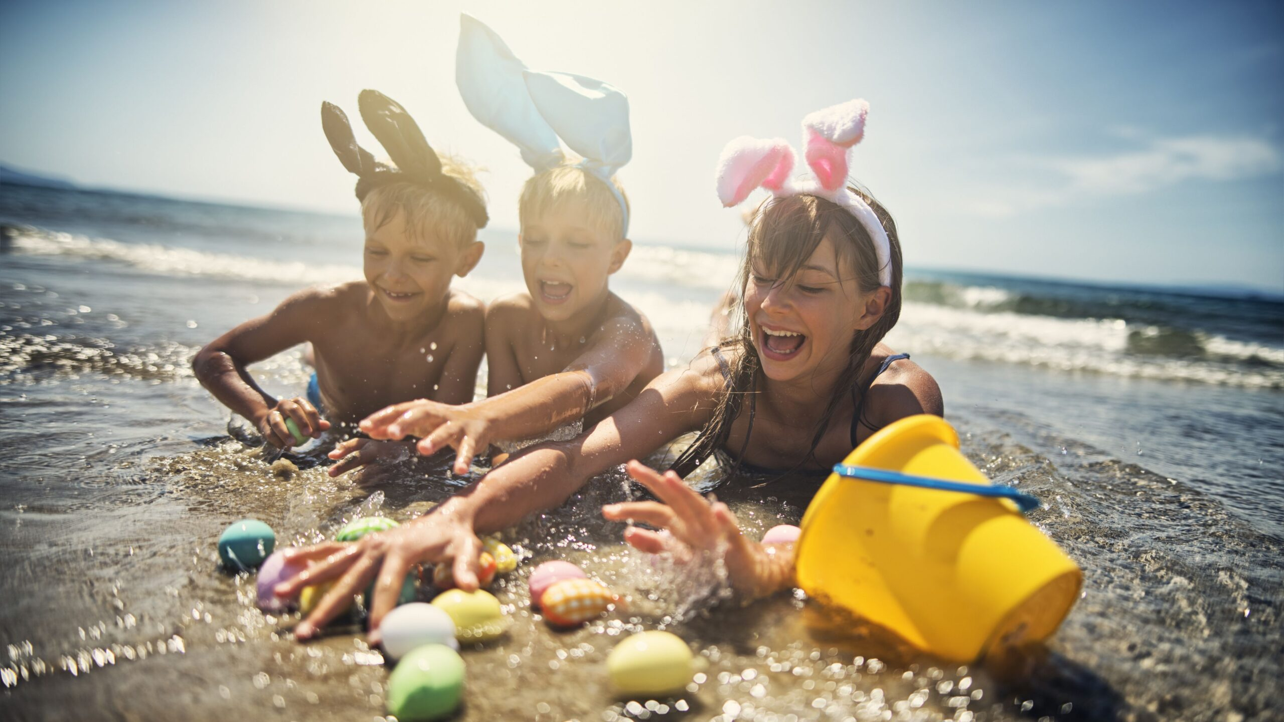 Kids playing in sea during summer easter 901432582 5c14485f46e0fb00014be1ff scaled